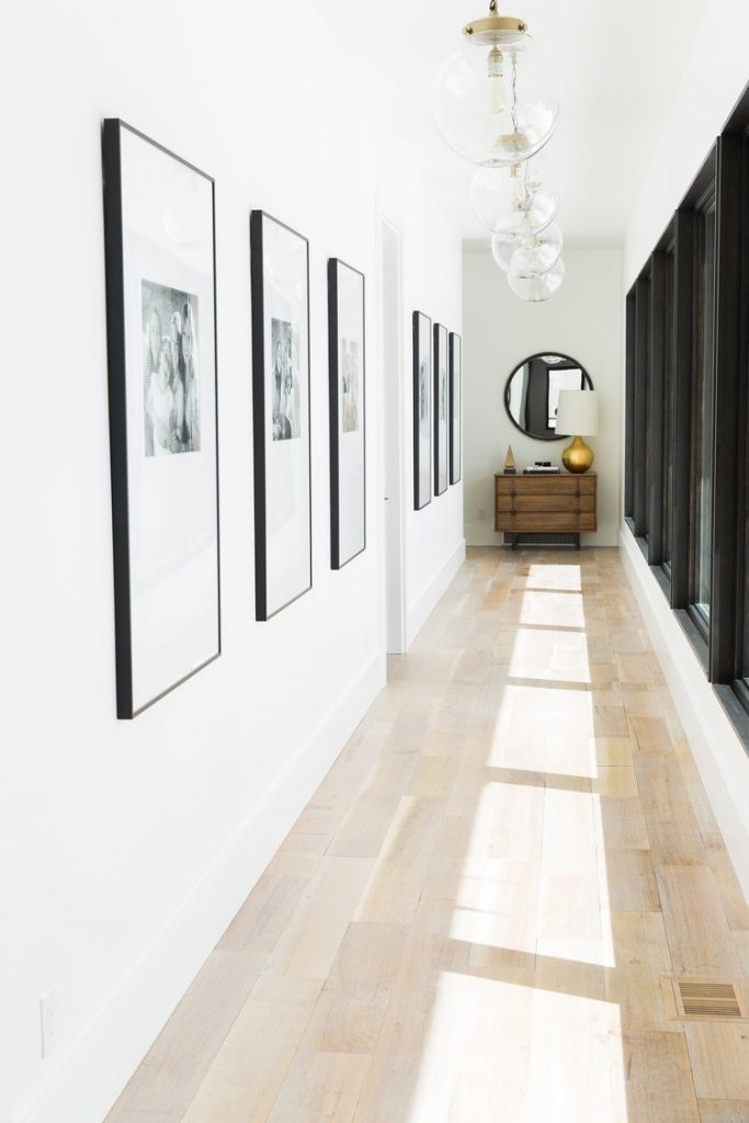 styling artwork and frames on a long hallway